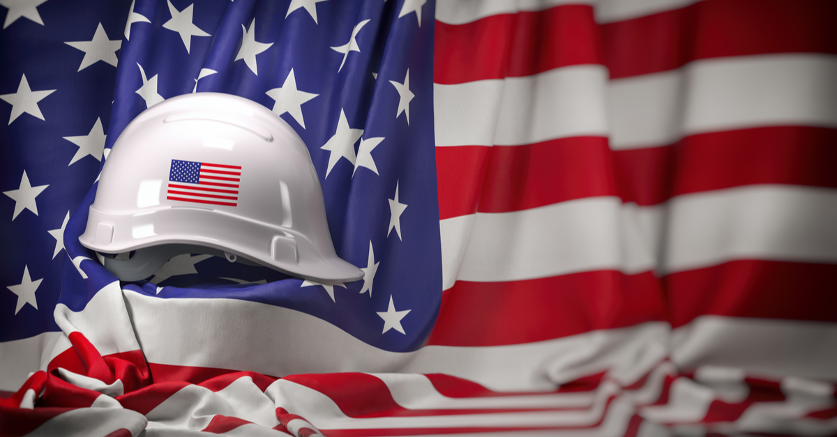 DST Advisory Group - National Manufacturing Day - American flag with construction hardhat
