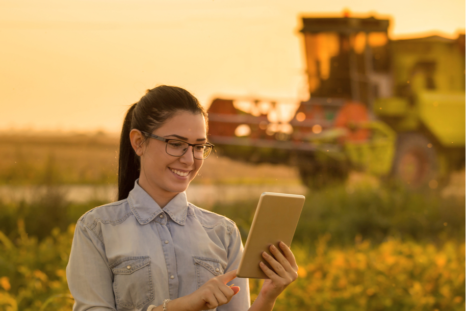 Agricultural sector - agronomist out in a farmer's field testing